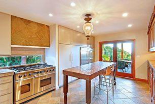 "Kitchen with Wood counters, Breakfast bar, U-shaped, Viking Professional Custom Series VGCC5486GSS 48"" Pro-Style Gas Range"
