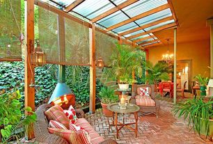 Tropical Patio with French doors, exterior brick floors, Herringbone brick floor