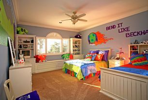 Eclectic Kids Bedroom with Carpet, Window seat, Ceiling fan, Mural, Crown molding, Arched window