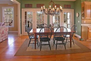 Country Dining Room with Chandelier, High ceiling, Crown molding, Hardwood floors, French doors