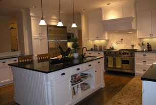 Traditional Kitchen with Kitchen island, Built-in bookshelf, Breakfast bar, U-shaped, Custom hood, Subway Tile, Pendant light