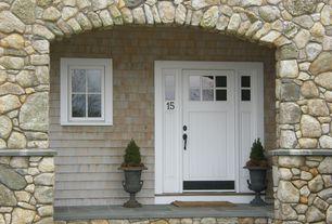 Cottage Front Door with exterior concrete tile floors, Glass panel door, exterior tile floors, Transom window, Casement
