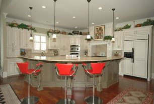 Traditional Kitchen with Pendant light, Custom hood, Simple granite counters, Large Ceramic Tile, L-shaped, Kitchen island