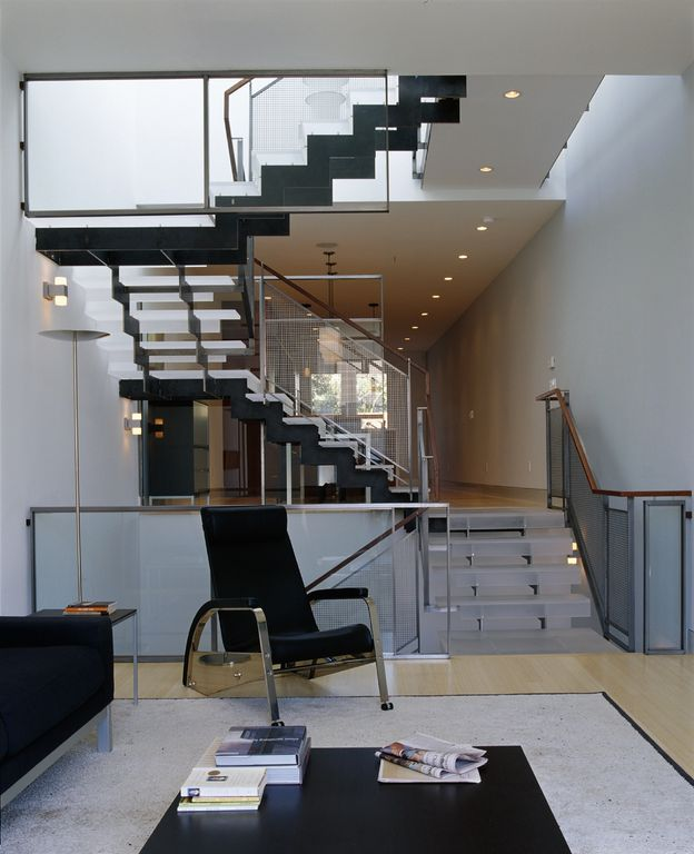 Contemporary Staircase with Metal staircase, Laminate floors, Wall sconce