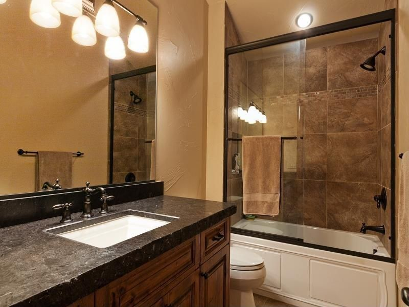 Craftsman Full Bathroom with Soapstone, Soapstone counters, Standard height, can lights, tiled wall showerbath, Paint 1