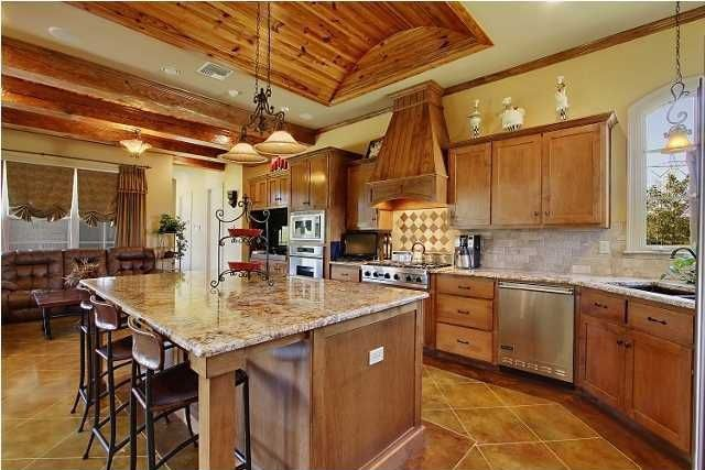 Craftsman Kitchen with Pendant light, limestone tile floors, Arched window, Flush, MS International Granite Golden Moon