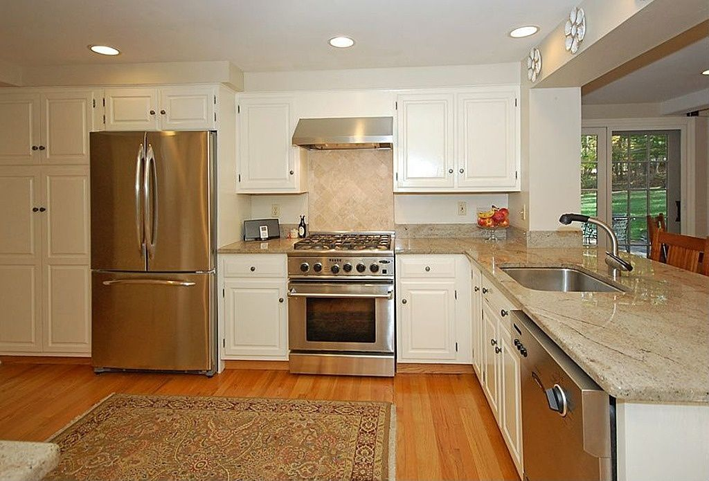 Traditional Kitchen with Ms international ivory 4 in. x 4 in. honed travertine floor and wall tile, Framed Partial Panel
