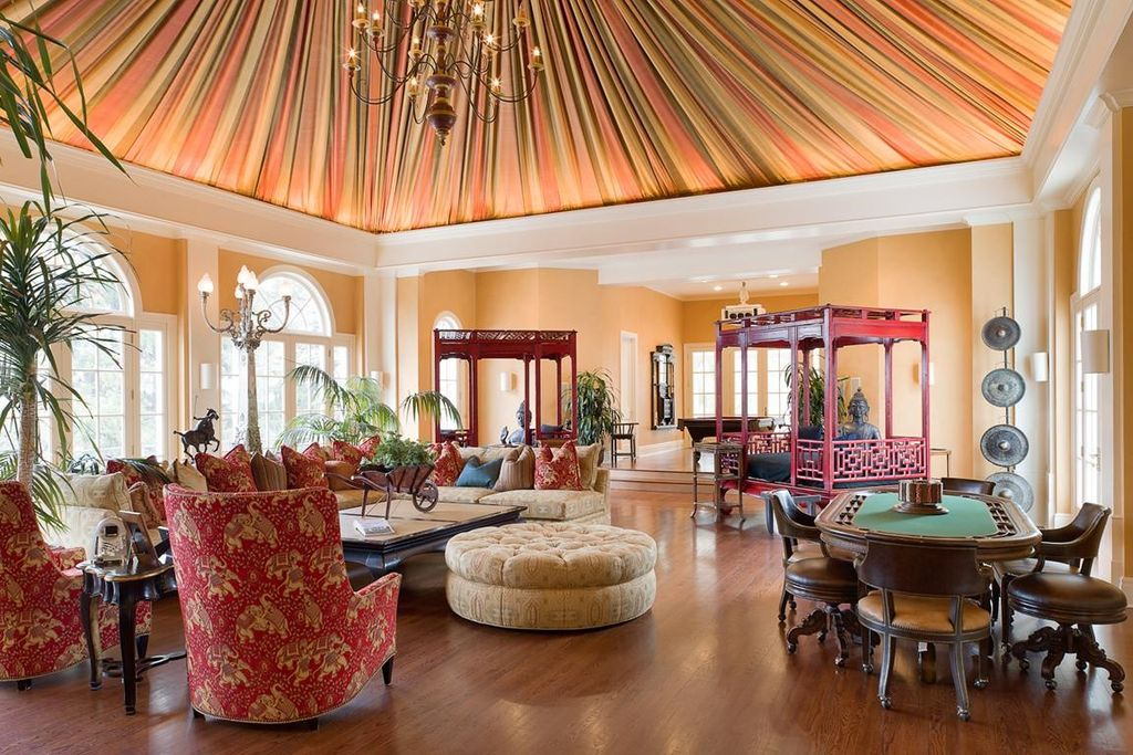 Eclectic Living Room with Dakota Double Pedestal Poker Table, tented ceiling, Upholstered armchair, Wheelbarrow planter