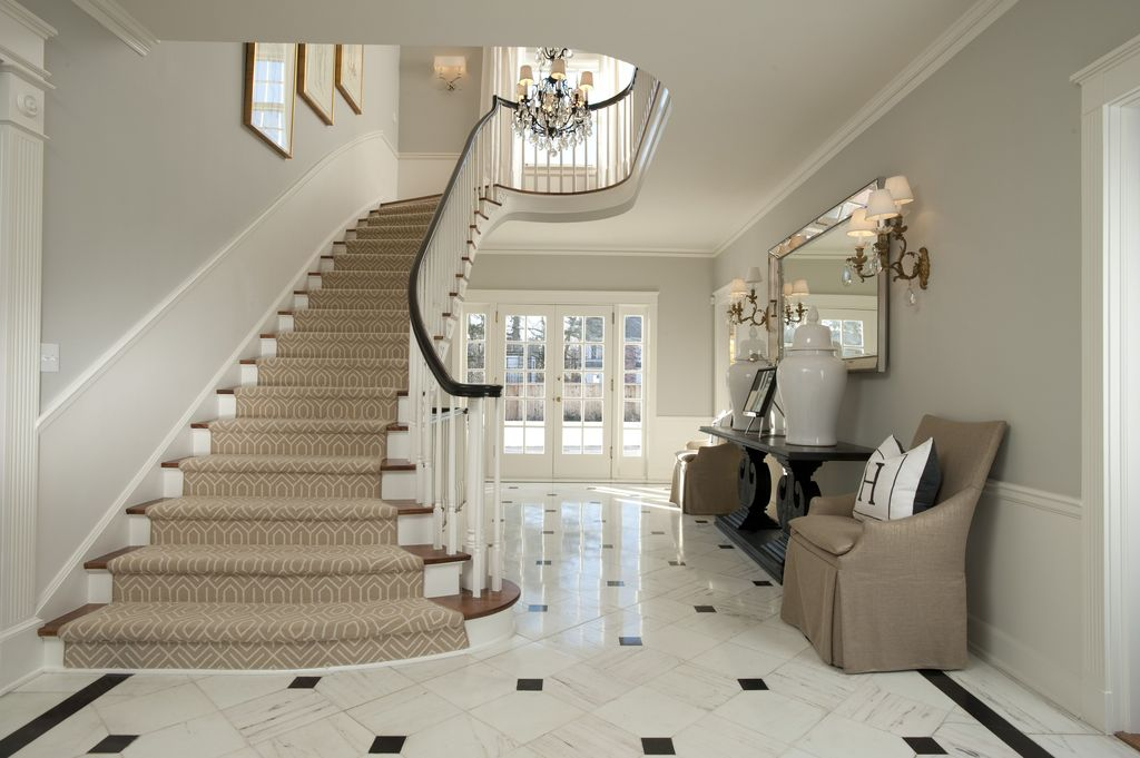 Traditional Staircase with Wall sconce, Wainscotting, Crown molding, High ceiling, Laminate floors