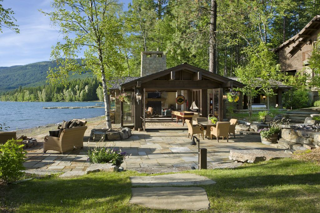 Rustic Patio with Deck Railing, specialty window, French doors, exterior stone floors, Pathway, Outdoor kitchen