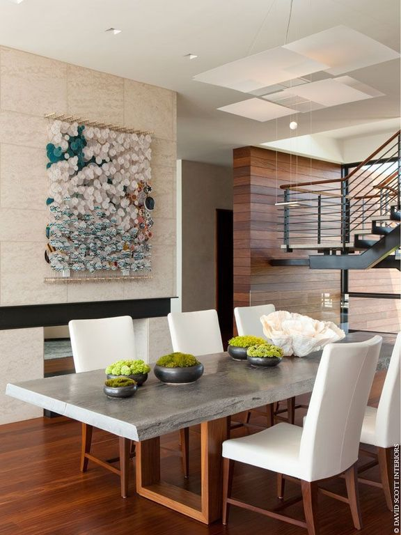 Contemporary Dining Room with stone fireplace, Pendant light, can lights, Fireplace, Laminate floors, High ceiling