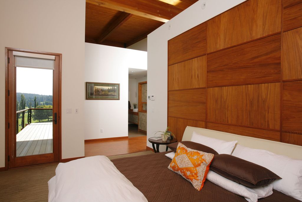 Contemporary Master Bedroom with Exposed beam, High ceiling, Glass panel door, Laminate floors