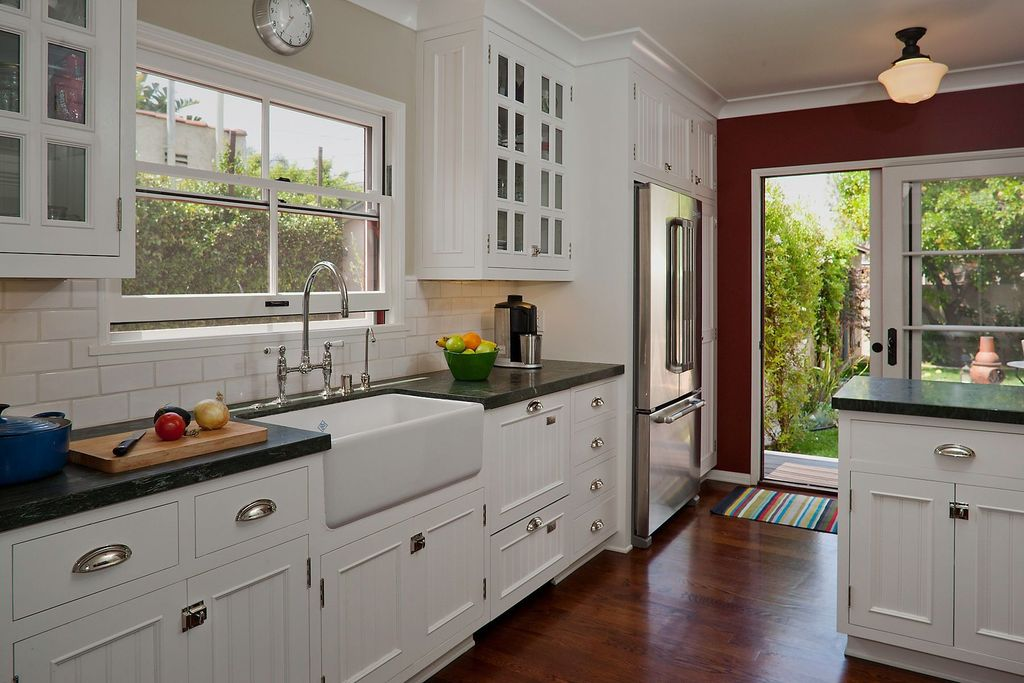 Cottage Kitchen with Stainless steel cup pull, Large Ceramic Tile, One-wall, Standard height, Farmhouse sink, French doors