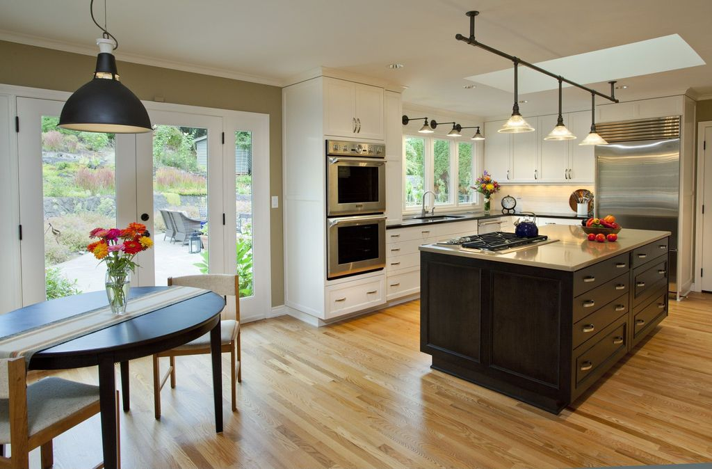 Contemporary Kitchen with full backsplash, 20th c. library single sconce - aged steel, Framed Partial Panel, can lights, Neo