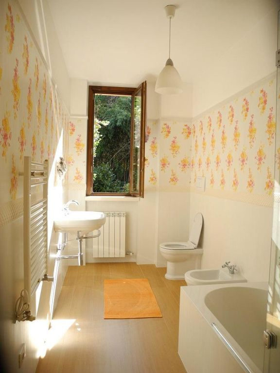 Cottage Full Bathroom with Wood floor, Eglo USA Coretto Glossy Pendant Light, Wall covering