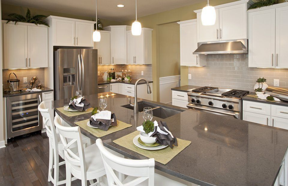Traditional Kitchen with Simple granite counters, Pendant light, full backsplash, wall oven, Flat panel cabinets, Subway Tile