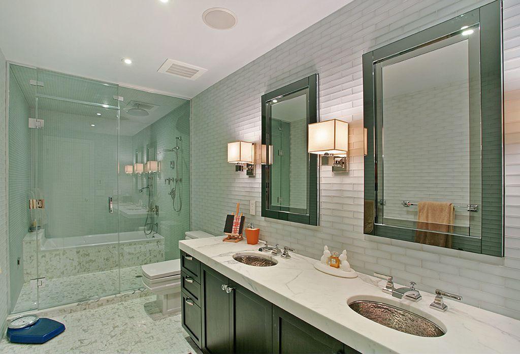 Contemporary Master Bathroom with Shower, Rain shower, frameless showerdoor, Standard height, penny tile floors, Flush