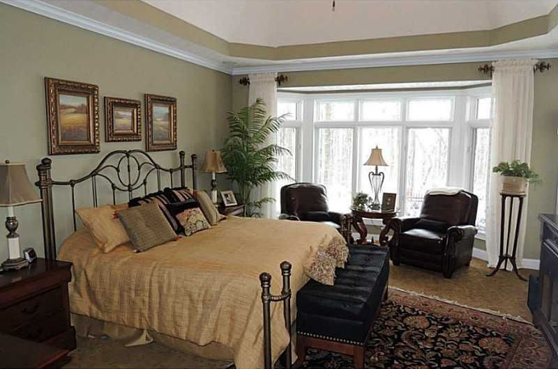 Traditional Master Bedroom with Standard height, Crown molding, Bay window, Carpet