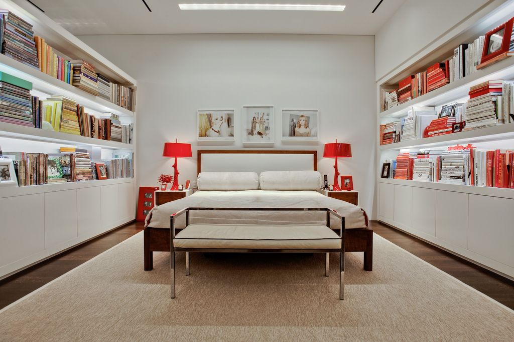Contemporary Master Bedroom with Built-in bookshelf, Hardwood floors, Standard height