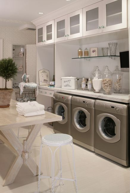 Traditional Laundry Room with Glazed porcelain floor tile, Floating glass shelf, Paint, Glass door cabinets