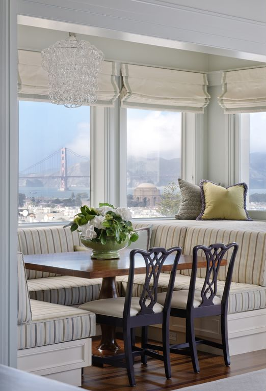Contemporary Dining Room with Window seat, Round glass chain chandelier, Urban city view, picture window, Paint, Chandelier