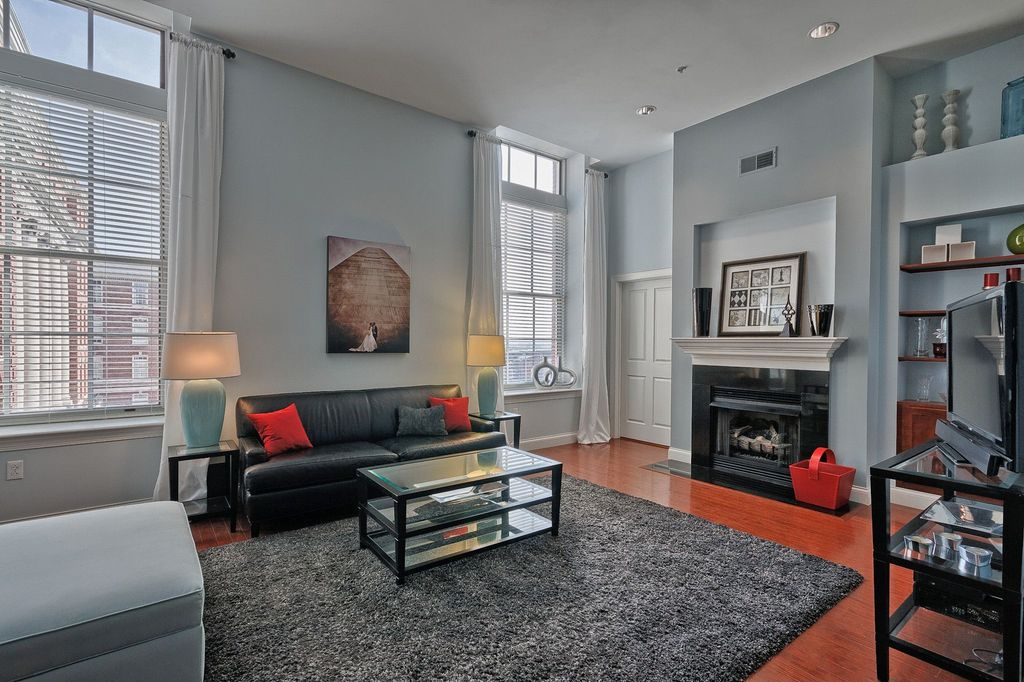 Contemporary Living Room with Built-in bookshelf, Fireplace, picture window, Standard height, can lights, double-hung window