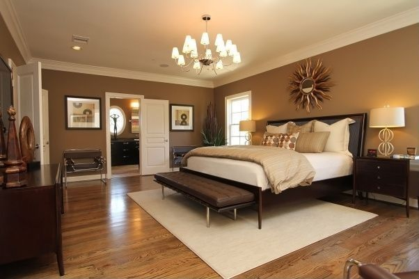 Modern Master Bedroom with Laminate floors, can lights, Mid-century french sunburst mirror, Chandelier, Crown molding, Paint