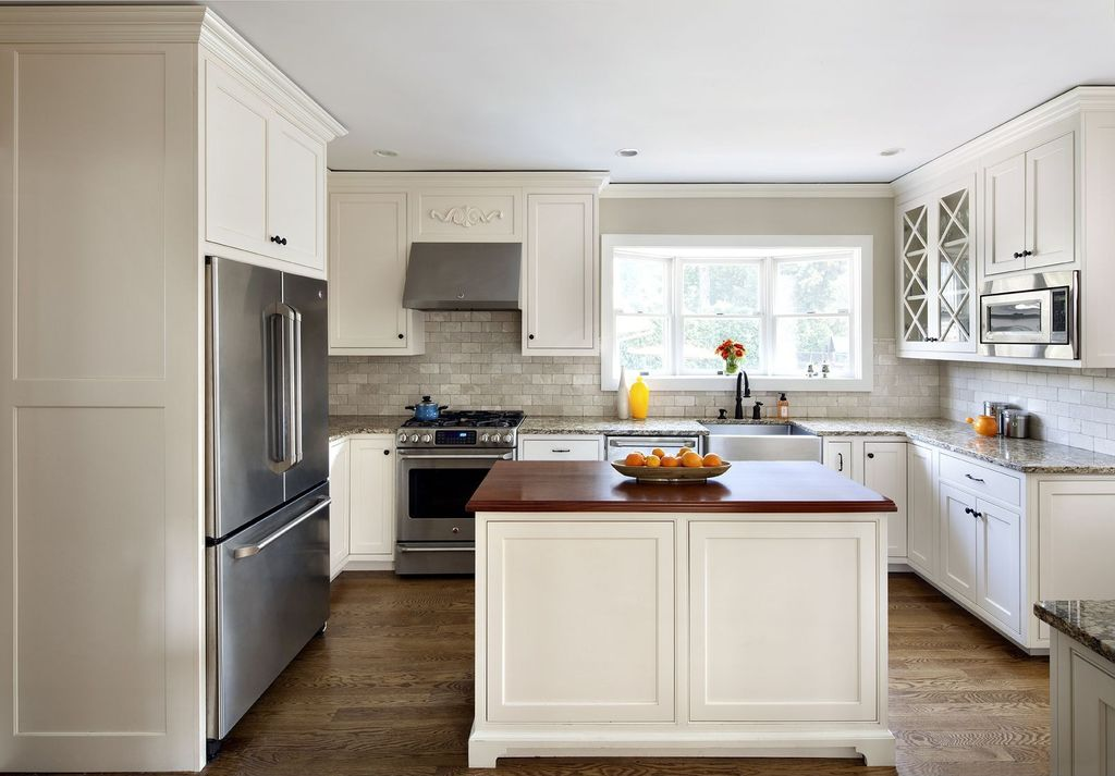 Traditional Kitchen with Limestone Tile, built-in microwave, Glass panel, dishwasher, can lights, Simple granite counters