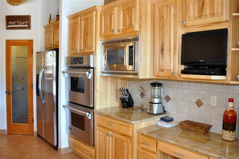 Rustic Kitchen with double wall oven, Complex granite counters, Limestone Tile, limestone tile floors, High ceiling, Paint