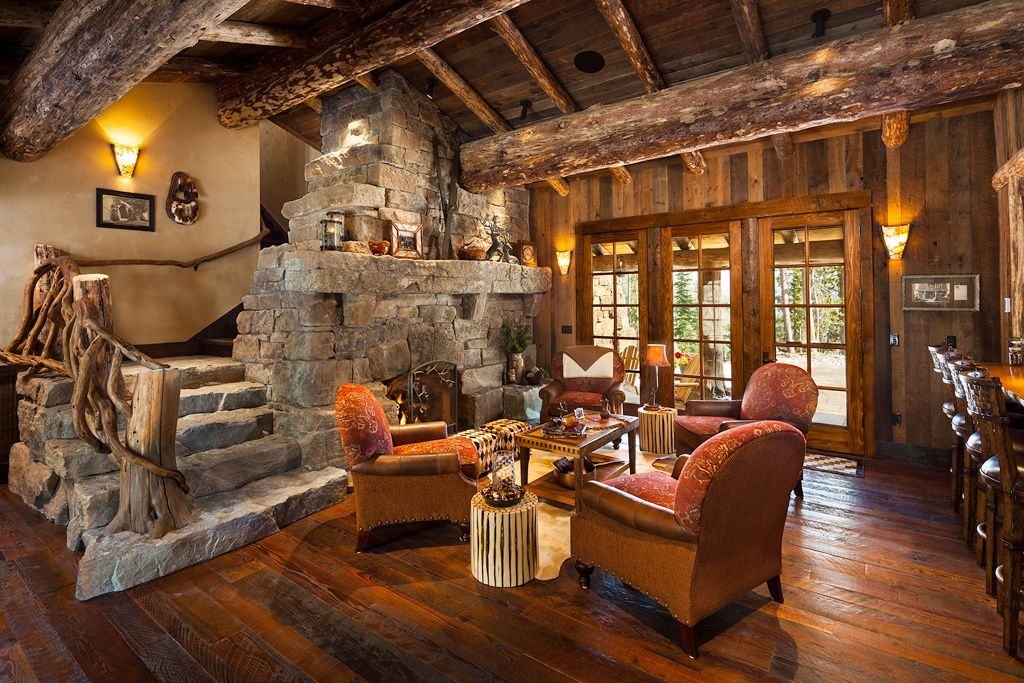 Rustic Living Room with Rustic wood flooring, Natural stone stairs, Exposed beam, Round rustic stick stool, Wood panel wall