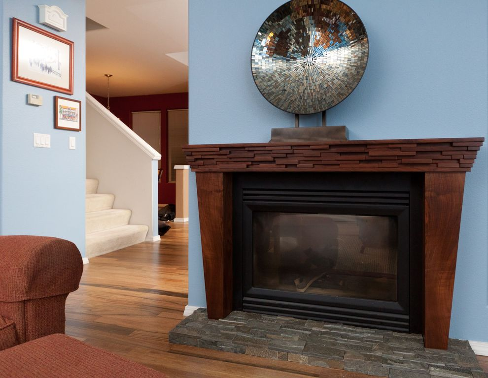 Modern Living Room with Cement fireplace, Exotics - Yorkshire Walnut 8 mm Laminate Wood Look, Fireplace, Paint 2, Paint