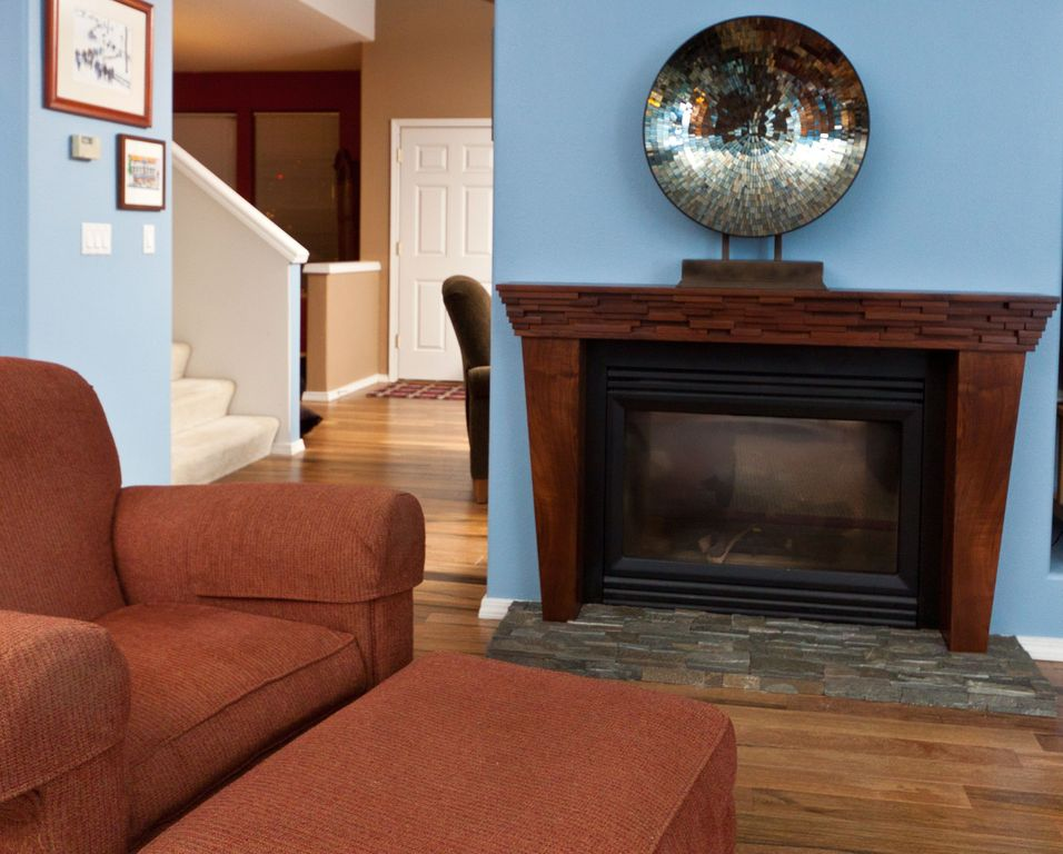 Modern Living Room with Laminate floors, other fireplace, Standard height, Fireplace