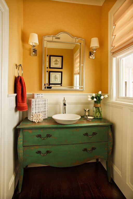 Eclectic Powder Room with Flush, Powder room, Wall sconce, Vessel sink, Wainscotting, Casement, Paint, Flat panel cabinets