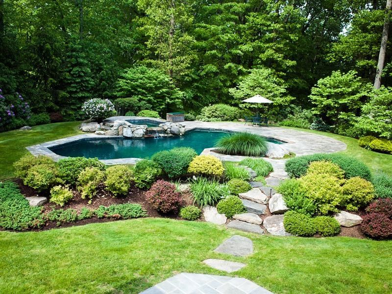 Rustic swimming pool with pathway pool with hot tub in for Garden pool from bathtub
