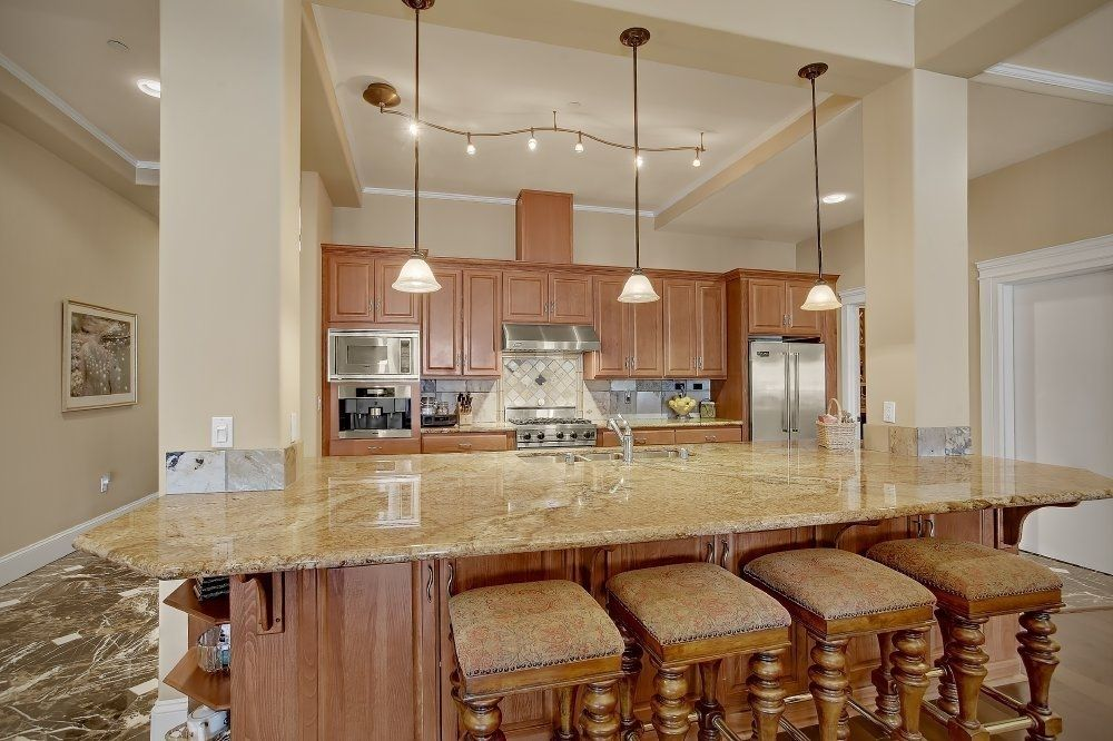 Traditional Kitchen with Breakfast bar, Simple granite counters, Dura Supreme Cabinetry Arcadia Classic Panel, Pendant light