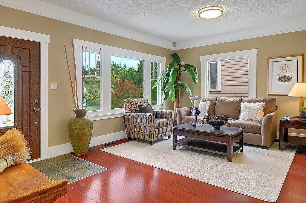 Craftsman Living Room with flush light, Paint 1, Hardwood floors, Standard height, Glass panel door, Crown molding, Casement