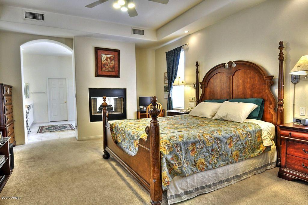 Eclectic Guest Bedroom with Fireplace, Casement, metal fireplace, Standard height, Carpet, flush light, six panel door