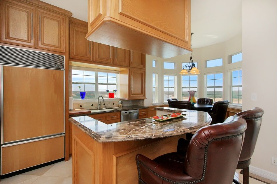 Traditional Kitchen with partial backsplash, High ceiling, Vinyl floors, Raised panel, Complex granite counters, dishwasher