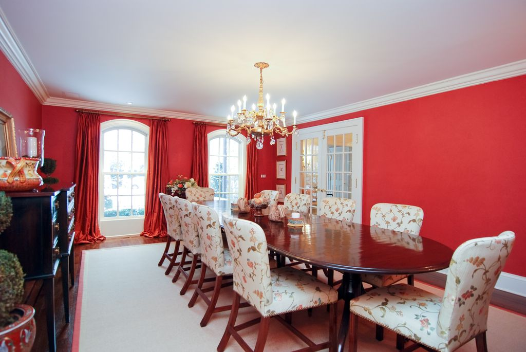 Traditional Dining Room with French doors, double-hung window, Hardwood floors, Chandelier, Arched window, Laminate floors