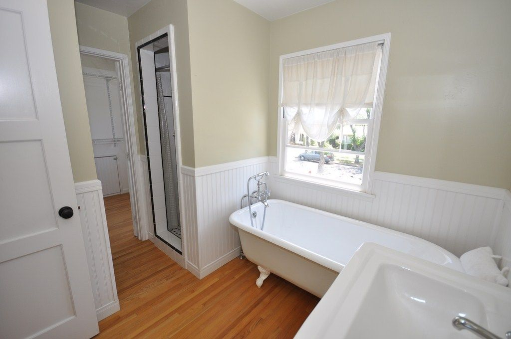 Traditional 3/4 Bathroom with Laminate floors, Wainscotting, 32 sq. ft. Beadboard White V-Groove Panel, Wall mounted sink