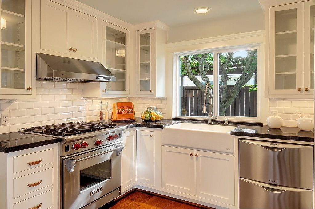 Traditional Kitchen with Subway tile backsplash, Black countertops, can lights, Casement, Stainless steel appliances, Paint 2