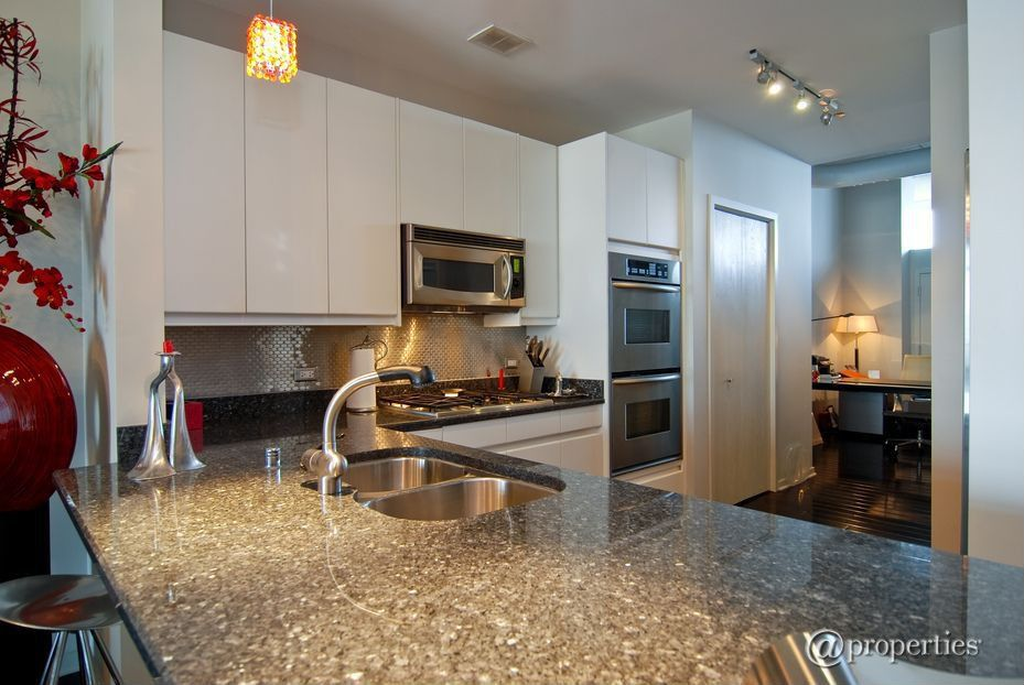 Contemporary Kitchen with electric cooktop, Penny Tile, Undermount sink, Transom window, Simple granite counters, can lights