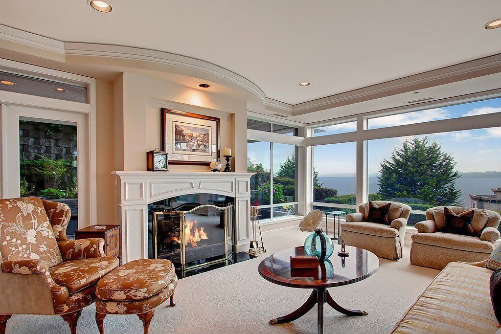 Traditional Living Room with Carpet, insert fireplace, picture window, Crown molding, specialty window, can lights, Fireplace