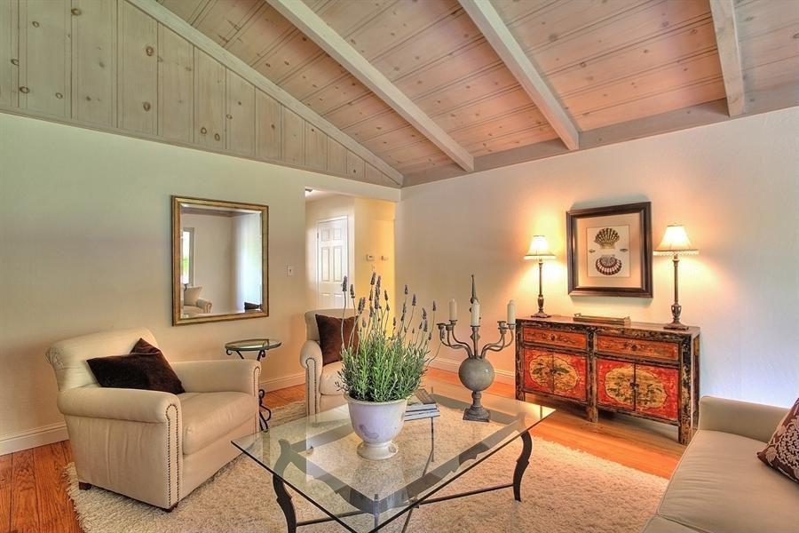 Eclectic Living Room with Built-in bookshelf, Carpet, High ceiling, specialty window, six panel door, Exposed beam