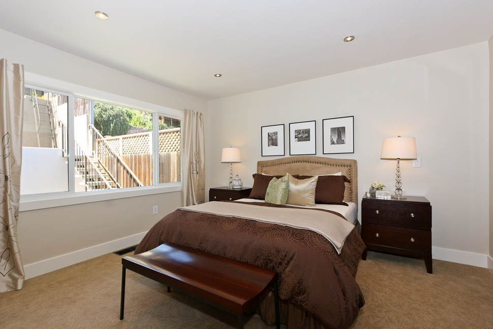 Contemporary Guest Bedroom with Standard height, specialty window, Carpet, can lights