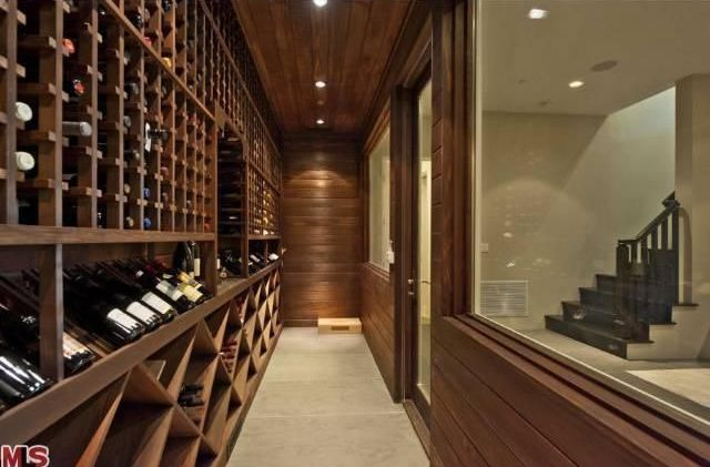 Contemporary Wine Cellar with Standard height, Built-in bookshelf, Concrete floors, picture window, can lights, French doors