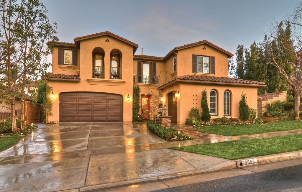 Mediterranean Front of Home with Pathway, exterior tile floors, Arched window