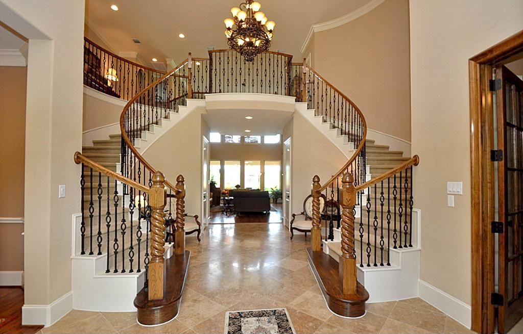 Traditional Staircase with Double staircase, Chandelier, Loft, simple marble floors, Cathedral ceiling