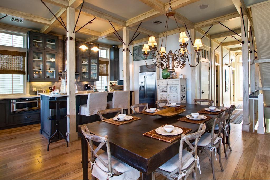 Eclectic Great Room with Pendant light, Standard height, Hardwood floors, Chandelier, Exposed beam, Columns, Casement