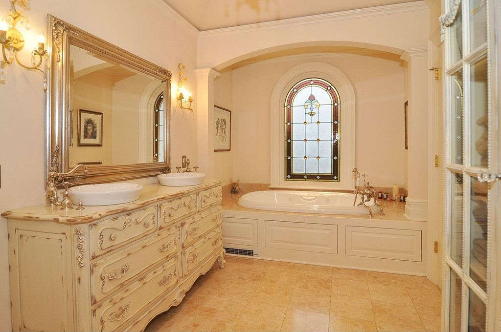 Traditional Master Bathroom with Uberhaus Round Vessel, Wood counters, Arched window, Master bathroom, Double sink, Bathtub